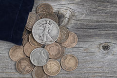 Bag of United States Rare Coins on Wood Stock Photo