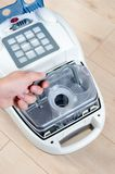 Bag less vacuum cleaner with plastic container Royalty Free Stock Image