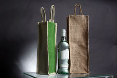 Bag for water or alcohol made out of recycled Hessian sack with Royalty Free Stock Photography