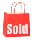 Bag with white sold sign Royalty Free Stock Photo