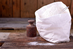 Bag of whole flour on wooden background Stock Photos