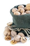 Bag with whole ripe walnuts Stock Photos