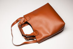 Bag. Woman's brown bag over white, top view stock photos