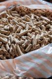 A bag of wood pellet. Vertical composition Stock Photos