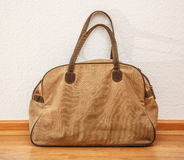 Bag on the wooden floor Royalty Free Stock Images