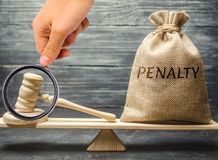 Bag with the word Penalty and gavel on the scales. Penalty as a punishment for a crime and offense. Fraud. The court`s decision. Appeal. Cancellation of fines stock photos