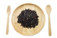 Baga do arroz em umas bacias de madeira com colher e forquilha Fotos de Stock
