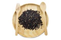 Baga do arroz em umas bacias de madeira com colher e forquilha Foto de Stock