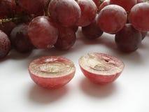 Baga suculenta do uvas cor-de-rosa em um corte Imagem de Stock