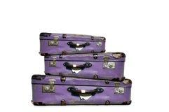 Bagaż, trzy purpurowej skrzynka Fotografia Royalty Free