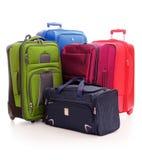 Bagage die uit koffers bestaat die op wit worden geïsoleerdb Stock Foto