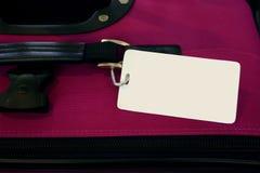 Bagage rose photographie stock libre de droits