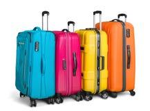 Bagage som består av stora resväskor som isoleras på royaltyfria bilder