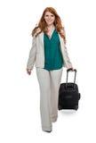 Bagagem levando da mulher de negócio Fotografia de Stock Royalty Free