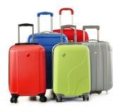 Bagagem que consiste nas malas de viagem isoladas no branco Fotos de Stock