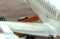 Bagages dans l'avion Photographie stock libre de droits