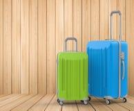 Bagages durs bleus et verts de cas Images libres de droits