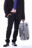 Bagagli della tenuta dell'uomo d'affari di viaggio Fotografie Stock