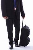 Bagagli della tenuta dell'uomo d'affari di viaggio Fotografia Stock