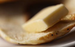 Bagal and butter macro Royalty Free Stock Photo