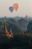 在Bagan塔的两个气球  免版税库存照片