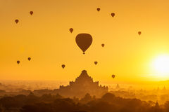 Bagan. Beautiful sunrise and hot air balloons over ancient pagoda in Bagan is old kingdom in past, Myanmar Royalty Free Stock Photo