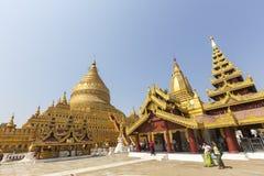 BAGAN - FEB 20, 2015 : Burmese womans visit Shwezigon Pagoda on Stock Photography