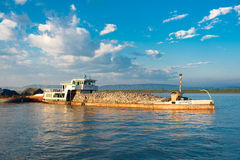 BAGAN, MIANMAR - DECEMBER 1, 2016: Cargo barge on the Irrawaddy River in Bagan, Myanmar. BAGAN, MIANMAR - DECEMBER 1, 2016: Cargo barge on the Irrawaddy River Stock Images