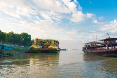 BAGAN, MIANMAR - DECEMBER 1, 2016: Tourist boat on the Irrawaddy River in Bagan, Myanmar. BAGAN, MIANMAR - DECEMBER 1, 2016: Tourist boat on the Irrawaddy River Stock Photo