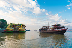 BAGAN, MIANMAR - DECEMBER 1, 2016: Tourist boat on the Irrawaddy River in Bagan, Myanmar. BAGAN, MIANMAR - DECEMBER 1, 2016: Tourist boat on the Irrawaddy River Royalty Free Stock Image