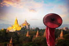 Bagan. Monk standing with holding umbrella, Bagan Mandalay Myanmar stock images