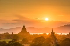 Bagan, Myanmar ancient temple ruins landscape in the archaeological zone. At dusk stock images