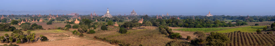 Bagan Myanmar, Burma. Wide panorama of ancient Buddhist temples Stock Photos
