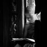 BAGAN, MYANMAR - Feb 18, Monk is reading Stock Photos