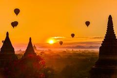 Bagan Myanmar Hot air balloons flying over stupas at Sunrise