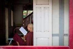 Bagan, Myanmar - 24 July 2014: Local Burmese monk is sitting by stock photo