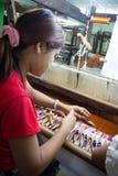 Bagan, Myanmar - 24 July 2014: Local Burmese woman is making clothes handloom stock image