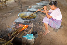 BAGAN, MYANMAR - November 19, 2015: Extracting oil from peanuts Royalty Free Stock Photos