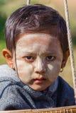 BAGAN, MYANMAR - NOVEMBER 26, 2014: an unidentified Burmese chil Stock Images