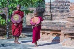Novice monks in bagan Myanmar. BAGAN , MYANMAR - SEP 05 2017: Novice monks in bagan Myanmar on September 05 2017 , The ruins of Bagan has 2,200 temples and royalty free stock image