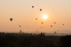 Bagan pagoda field with hot air balloons Stock Photos