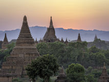 Bagan Temples sunset 2. Buddhist stupas rising from the plains among trees at sunset stock image