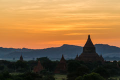 Bagan temples at sunset against mountains Royalty Free Stock Photos