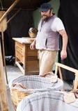 Bagaren vilar i gatabageri Fotografering för Bildbyråer