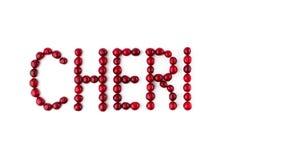 Bagas da cereja no fundo branco Fonte do fruto, letras 4K param o movimento filme