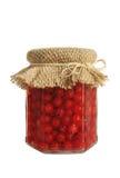 Bagas enlatadas da passa de Corinto vermelha no frasco Fotografia de Stock
