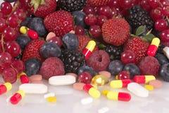 Bagas, vitaminas e suplementos nutritivos Imagens de Stock