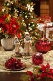 Bagattelle, candele ed altra di Natale su fondo di defocused Immagini Stock Libere da Diritti