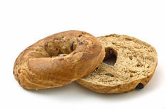 Bagel. Fresh baked cinnamon and raisin bagel isolated on white background in horizontal format royalty free stock image