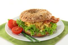 Bagel. With salad, scrambled eggs and crispy bacon stock photography
